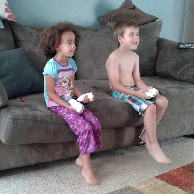Cousins playing Phineas and Ferb on the wii. They're so darn cute!