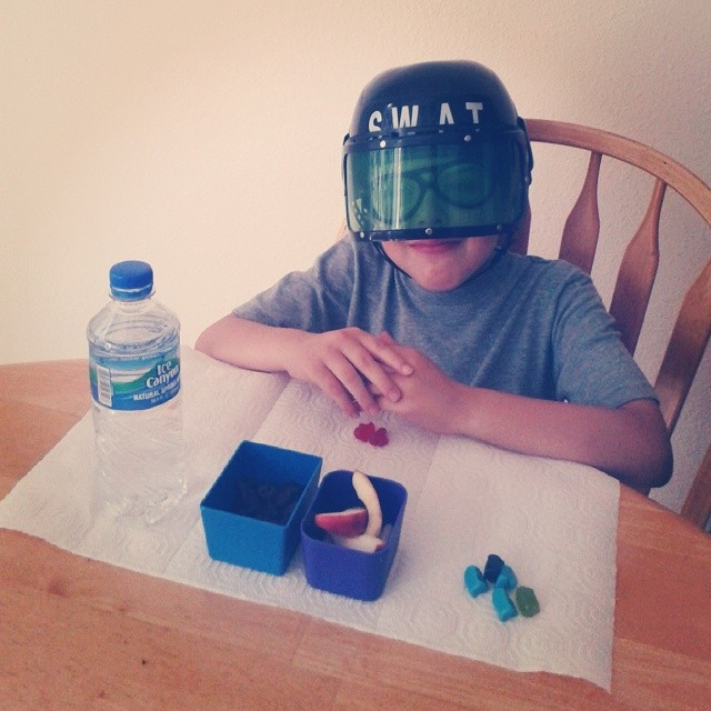 Little goober kept telling me it was hard to eat with his SWAT gear on but refused to take it off :-)