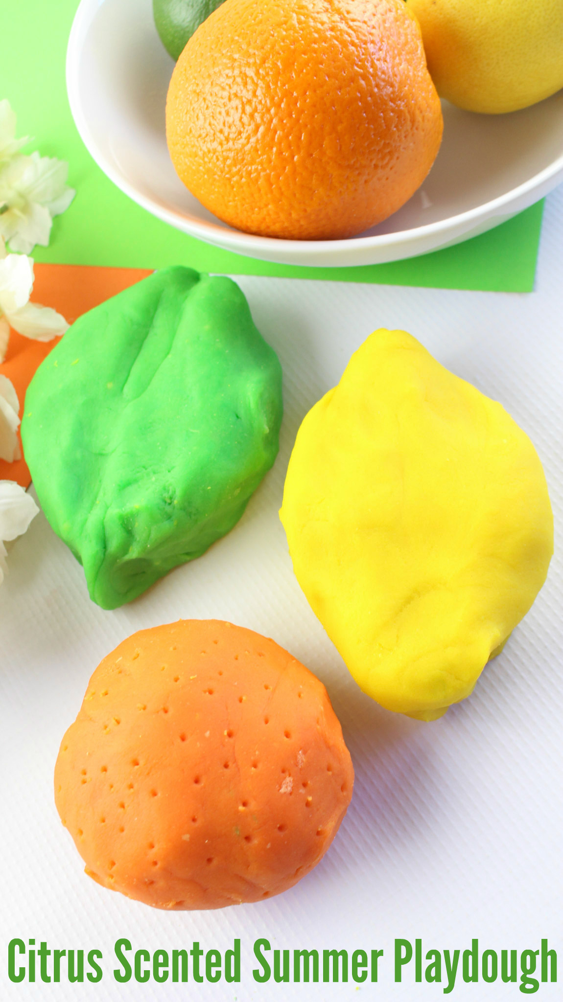 Citrus Scented Summer Playdough - I  love making playdough that smells and looks like the season we're in. For Summer, citrus is the way to go! This Citrus Scented Summer Playdough recipe will make the whole house smell cheery & bright and your kids will have a blast playing with it!